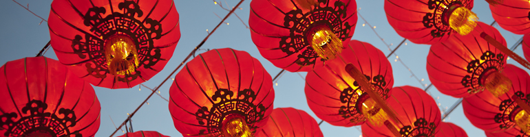 Red lanterns hang from a string during the Chinese New Year, signifying a new animal is ruling the year.